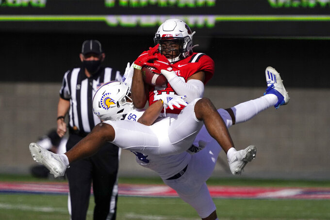 Ball State safety Brett Anderson II (23) intercepts a pass intended for San Jose State wide receiver Isaiah Hamilton during the second half of the Arizona Bowl NCAA college football game Thursday, Dec. 31, 2020, in Tucson, Ariz. Ball State won 34-13. (AP Photo/Rick Scuteri)