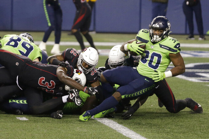 Seattle Seahawks running back Carlos Hyde (30) scores a touchdown against the Arizona Cardinals during second first half of an NFL football game, Thursday, Nov. 19, 2020, in Seattle. (AP Photo/Lindsey Wasson)