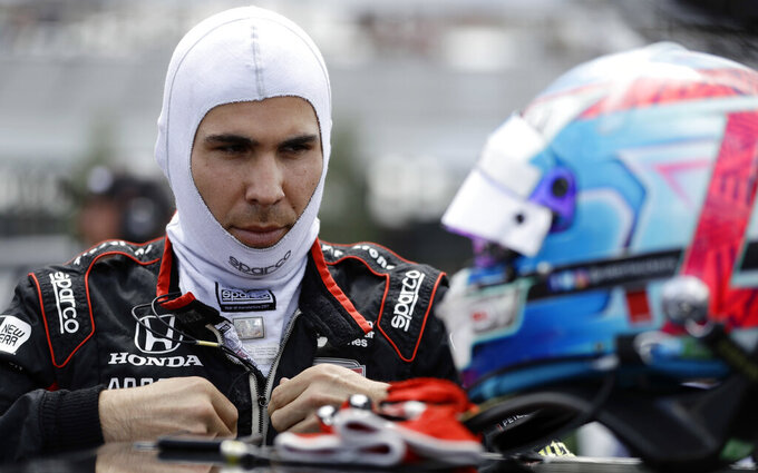 FILE - In this Aug. 18, 2018, file photo, Robert Wickens prepares to qualify for an IndyCar series auto race in Long Pond, Pa. The first IndyCar race of the season will mark returns to the track for both A.J. Foyt and paralyzed driver Robert Wickens. Wickens suffered a spinal cord injury in a crash last August and has been rehabilitating in Denver the last several months. The Canadian said he will be part of IndyCar's driver autograph session at St. Petersburg and participate in a fan event Sunday before the race. (AP Photo/Matt Slocum, File)