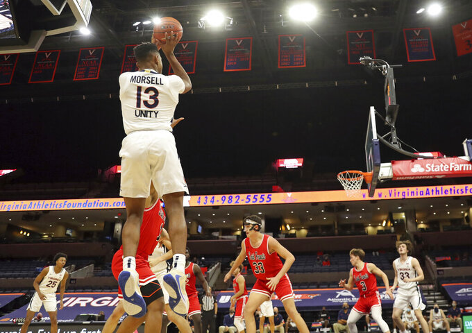 Virginia guard Casey Morsell (13) shoots a 3-pointerover St. Francis defenders during an NCAA college basketball game Tuesday, Dec. 1, 2020, in Charlottesville, Va. (Andrew Shurtleff/The Daily Progress via AP)