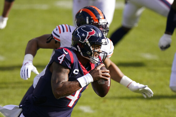 Houston Texans quarterback Deshaun Watson (4) runs during the first half of an NFL football game against the Chicago Bears, Sunday, Dec. 13, 2020, in Chicago. (AP Photo/Nam Y. Huh)