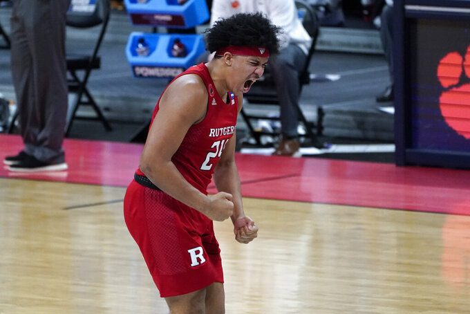 Rutgers guard Ron Harper Jr. (24) celebrates beating Clemson 60-56 after a men's college basketball game in the first round of the NCAA tournament at Bankers Life Fieldhouse in Indianapolis, Friday, March 19, 2021. (AP Photo/Paul Sancya)
