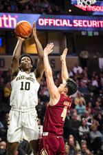 Wake Forest forward Jaylen Hoard (10) shoots over Boston College guard Chris Herren (4) during an NCAA college basketball game, Saturday, Jan. 26, 2019, in Winston-Salem, N.C. (Andrew Dye/The Winston-Salem Journal via AP)