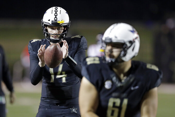 Vanderbilt quarterback Kyle Shurmur (14) warms up before an NCAA college football game against Mississippi Saturday, Nov. 17, 2018, in Nashville, Tenn. (AP Photo/Mark Humphrey)