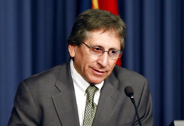 FILE - In this March 5, 2015, file photo, Maricopa County prosecutor Juan Martinez speaks during a news conference in Phoenix. The former Arizona prosecutor, known for winning a conviction in the Jodi Arias murder case, has agreed to be disbarred in an ethics case in which he was accused of leaking the identity of an Arias juror and sexually harassing female law clerks in his office. Martinez agreed on Friday, July 17, 2020, to give up his license to practice law. (AP Photo/Matt York, File)