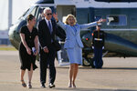 First lady Jill Biden reacts as she and President Joe Biden meet veterans of the British Armed Forces before boarding Air Force One at Heathrow Airport in London, Sunday, June 13, 2021. (AP Photo/Patrick Semansky)