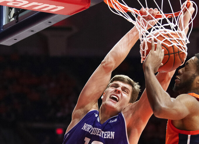 FILE - In this  March 3, 2019, file photo, Northwestern forward Miller Kopp, left, dunks the ball against Illinois guard Alan Griffin during the second half of an NCAA college basketball game in Champaign, Ill. Northwestern hopes to find its footing coming off back-to-back losing seasons since the school that hosted the NCAA's inaugural Final Four made the tournament for the first time. (AP Photo/Stephen Haas, File)