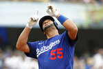 Los Angeles Dodgers' Albert Pujols reacts at the plate after hitting a solo home run against the New York Mets during the first inning of a baseball game in Los Angeles, Saturday, Aug. 21, 2021. (AP Photo/Alex Gallardo)