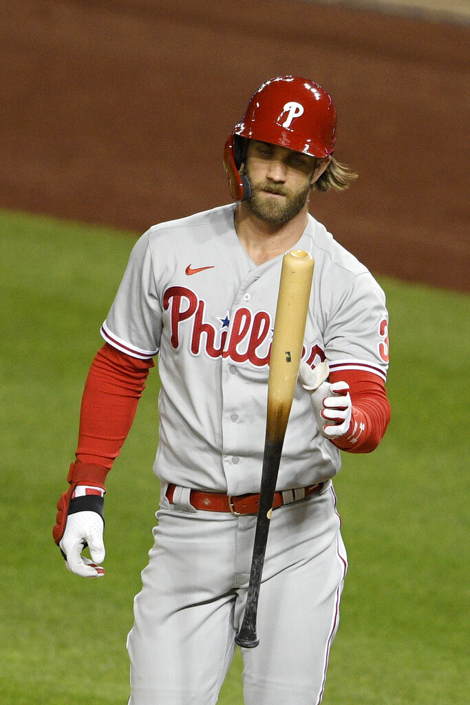 Philadelphia Phillies' Bryce Harper reacts after striking out during the fifth inning of a baseball game against the Washington Nationals, Monday, Sept. 21, 2020, in Washington. (AP Photo/Nick Wass)