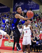 Duke guard Tre Jones (3) goes up for a basket over San Diego State during the first half of an NCAA college basketball game at the Maui Invitational, Monday, Nov. 19, 2018, in Lahaina, Hawaii. (AP Photo/Marco Garcia)