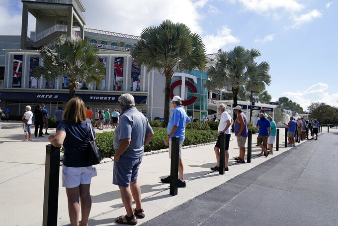Minnesota Twins fans wait in line for tickets during spring training baseball practice on Wednesday, Feb. 24, 2021, in Fort Myers, Fla. (AP Photo/Brynn Anderson)