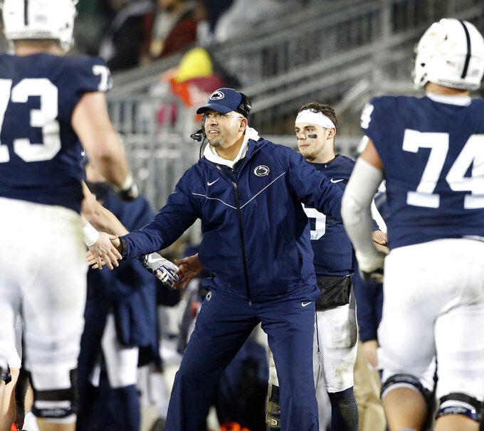 Penn State head coach James Franklin, congratulates his players after a touchdown against Maryland during the second half of an NCAA college football game in State College, Pa., Saturday, Nov. 24, 2018. Penn State won 38-3. (AP Photo/Chris Knight)