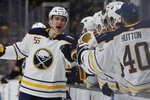 Buffalo Sabres defenseman Rasmus Ristolainen (55) celebrates his goal with teammates on the bench during the first period of an NHL hockey game against the Boston Bruins, Thursday, Nov. 21, 2019, in Boston. (AP Photo/Elise Amendola)