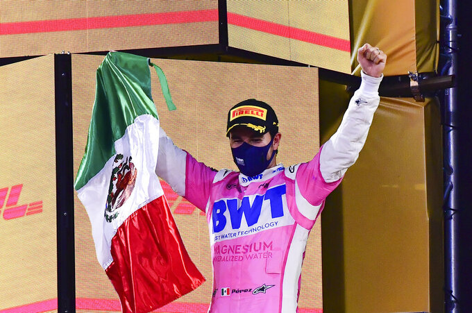 Racing Point driver Sergio Perez of Mexico celebrates after he won the Formula One Bahrain Grand Prix in Sakhir, Bahrain, Sunday, Dec.6, 2020. (Giuseppe Cacace, Pool via AP)