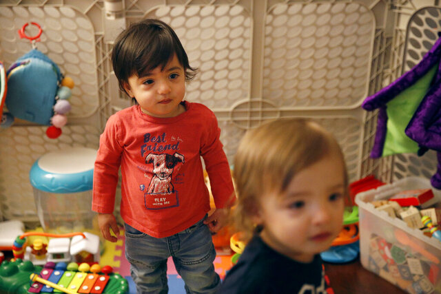 FILE - This Jan. 23, 2018, file photo shows 16-month-old Ethan Dvash-Banks, left, and his twin brother, Aiden, playing in the living room of their apartment in Los Angeles. A federal appeals court has ruled against the U.S. State Department in its quest to deny the citizenship of the son born abroad to a gay married couple. In a decision issued Oct. 9, 2020, the 9th U.S. Circuit Court of Appeals unanimously upheld a lower court ruling recognizing the citizenship from birth of Ethan Dvash-Banks, a twin boy born abroad by surrogacy to Andrew and Elad Dvash-Banks, a married gay couple. (AP Photo/Jae C. Hong, File)