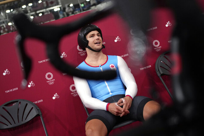 Hugo Barrette of Team Canada waits to compete during the track cycling men's sprint at the 2020 Summer Olympics, Wednesday, Aug. 4, 2021, in Izu, Japan. (AP Photo/Christophe Ena)