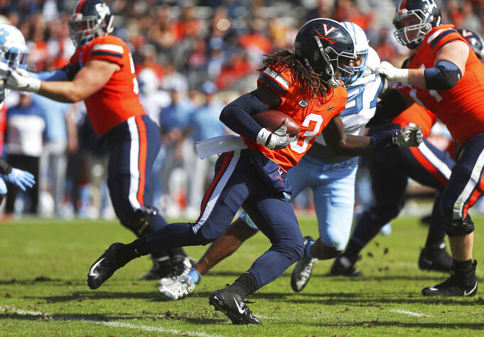 Virginia's quarterback Bryce Perkins (3) turns the corner on a run during the first half of an NCAA college football game against North Carolina, Saturday, Oct. 27, 2018, in Charlottesville, Va. (Zack Wajsgras /The Daily Progress via AP)