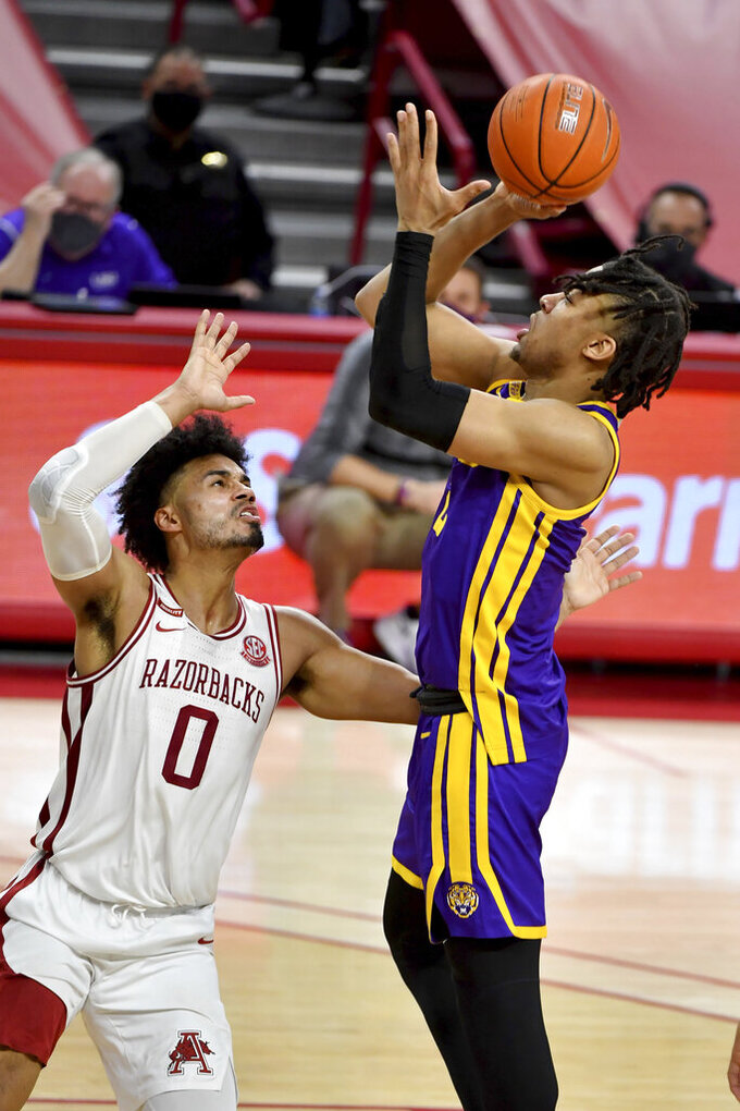 LSU forward Trendon Watford (2) shoots over Arkansas forward Justin Smith (0) during the second half of an NCAA college basketball game in Fayetteville, Ark. Saturday, Feb. 27, 2021. (AP Photo/Michael Woods)