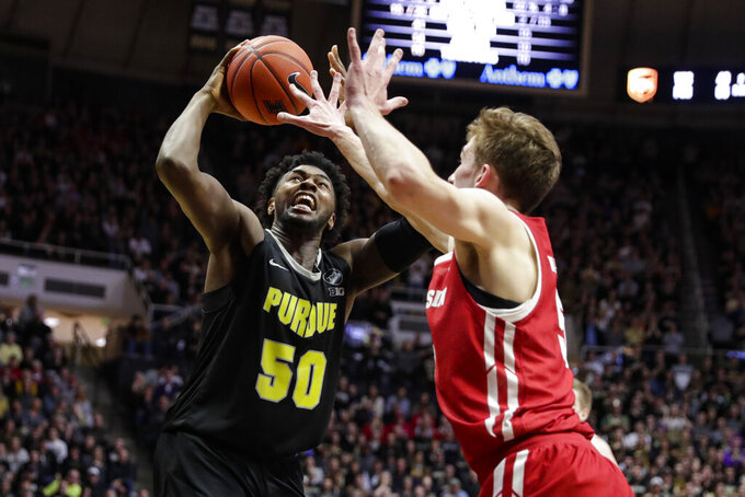 Purdue forward Trevion Williams (50) shoots over Wisconsin forward Tyler Wahl (5) during the second half of an NCAA college basketball game in West Lafayette, Ind., Friday, Jan. 24, 2020. (AP Photo/Michael Conroy)