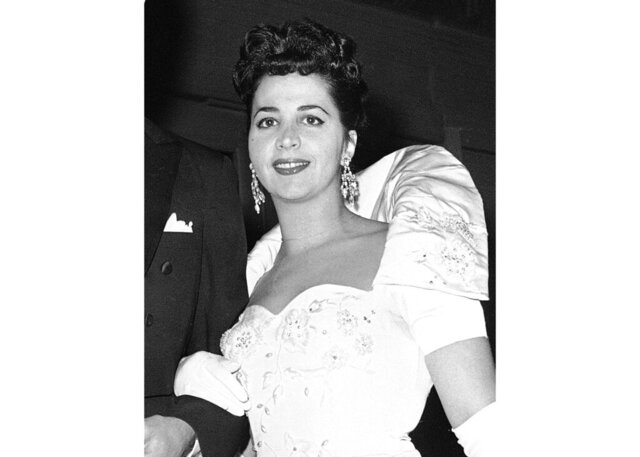 FILE - This Oct. 26, 1959 file photo shows American mezzo-soprano Rosalind Elias arriving at the Metropolitan Opera House in New York to attend a performance of Verdi's