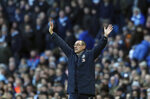 Chelsea manager Maurizio Sarri gives instructions to his players during the English Premier League soccer match between Manchester City and Chelsea at Etihad stadium in Manchester, England, Sunday, Feb. 10, 2019. (AP Photo/Jon Super)