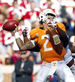 Tennessee quarterback Jarrett Guarantano (2) attempts to throw to a receiver as he is sacked by Alabama defensive back Xavier McKinney (15) in the first half of an NCAA college football game against Alabama Saturday, Oct. 20, 2018, in Knoxville, Tenn. (AP Photo/Wade Payne)