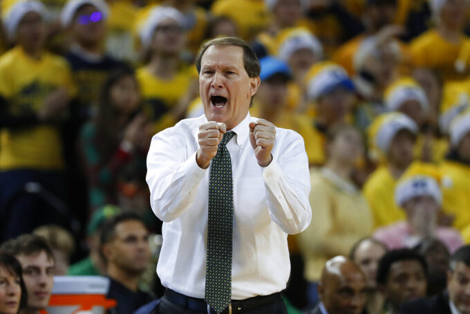 Oregon head coach Dana Altman reacts to a play against Michigan in the first half of an NCAA college basketball game in Ann Arbor, Mich., Saturday, Dec. 14, 2019. (AP Photo/Paul Sancya)