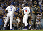 Los Angeles Dodgers' Enrique Hernandez (14) celebrates his two-run home run with Max Muncy (13) during the fourth inning of the team's baseball game against the Arizona Diamondbacks on Tuesday, July 2, 2019, in Los Angeles. (AP Photo/Marcio Jose Sanchez)