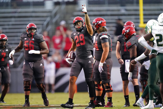 North Carolina State wide receiver Christopher Toudle (29) reacts following a play against South Florida during the first half of an NCAA college football game in Raleigh, N.C., Thursday, Sept. 2, 2021. (AP Photo/Gerry Broome)