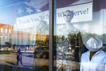 Mannequins stand in a window paying tribute to military and public service members along a downtown street in Palatka, Fla., Tuesday, April 13, 2021. (AP Photo/David Goldman)
