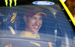 Driver Joey Logano sits in his car waiting to practice for the NASCAR Cup Series auto race at Kansas Speedway in Kansas City, Kan., Friday, May 10, 2019. (AP Photo/Colin E. Braley)