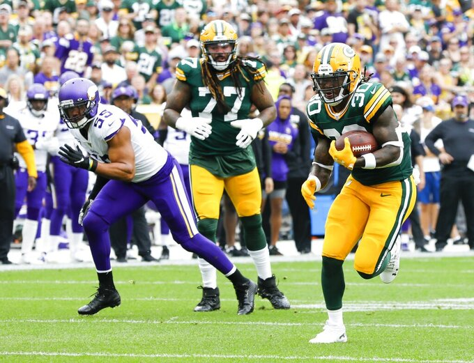 Green Bay Packers' Jamaal Williams runs for a touchdown during the first half of an NFL football game against the Minnesota Vikings Sunday, Sept. 15, 2019, in Green Bay, Wis. (AP Photo/Mike Roemer)