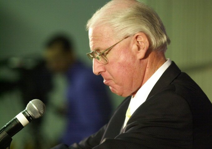 FILE - In this Nov. 15, 2005, file photo, Kansas State football coach Bill Snyder holds back tears as he announces that he will step down and retire after a game with Missouri, in Manhattan, Kan. Kansas State has gone through the unenviable process of replacing a legend once before, and results were so disappointing that Bill Snyder came out of retirement to put the program back on track. Now, the Wildcats get a do-over. The 79-year-old Snyder announced in a statement Sunday, Dec. 2, 2018, he was retiring for a second and final time as the coach at Kansas State. (AP Photo/The Wichita Eagle, Jeff Tuttle, File)/The Wichita Eagle via AP)