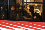 A woman wears a mask as she travels on a public bus in downtown Tehran, Iran, Thursday, Feb. 27, 2020. Amid fear and uncertainty caused by the spread of a new virus, Iranians are taking extra caution to avoid getting infected, as authorities canceled Friday prayers in Tehran, Qom and other cities. (AP Photo/Vahid Salemi)