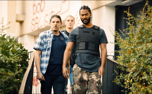 This image released by Amazon Studios shows, from left, Damien Bonnard, Alexis Manenti and Djebril Zonga in a scene from