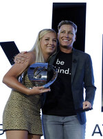 Kelley Lynch, left, a softball player for East Coweta High School in Sharpsburg, Ga., poses for photo with former U.S. Women's soccer national team member Abby Wambach after Lynch was named High School Athlete of the Year at an awards banquet Tuesday, July 9, 2019, in Los Angeles. (AP Photo/Marcio Jose Sanchez)