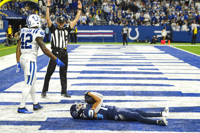 Tennessee Titans wide receiver Kalif Raymond (14) lies in the end zone after a touchdown in front of Indianapolis Colts defensive back Rolan Milligan (42) during the second half of an NFL football game in Indianapolis, Sunday, Dec. 1, 2019. (AP Photo/AJ Mast)