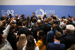 Visitors attend a briefing at the COP25 climate talks congress in Madrid, Spain, Saturday, Dec. 14, 2019. The United Nations Secretary-General has warned that failure to tackle global warming could result in economic disaster. (AP Photo/Manu Fernandez)