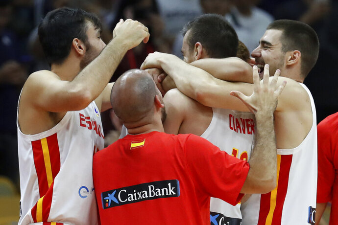 Spanish team players celebrate after defeating Serbia in their Group J second phase match for the FIBA Basketball World Cup, at the Wuhan Sports Center in Wuhan in central China's Hubei province, Sunday, Sept. 8, 2019. (AP Photo/Andy Wong)