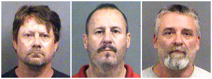FILE - This combination of Oct. 14, 2016, file booking photos provided by the Sedgwick County Sheriff's Office in Wichita, Kan., shows from left, Patrick Stein, Curtis Allen and Gavin Wright, three members of a Kansas militia group who were charged with plotting to bomb an apartment building filled with Somali immigrants in Garden City, Kan. Attorneys for the three men have asked the court to bar at sentencing any victim impact statements, arguing no one was actually hurt. Prosecutors say the men are trying to