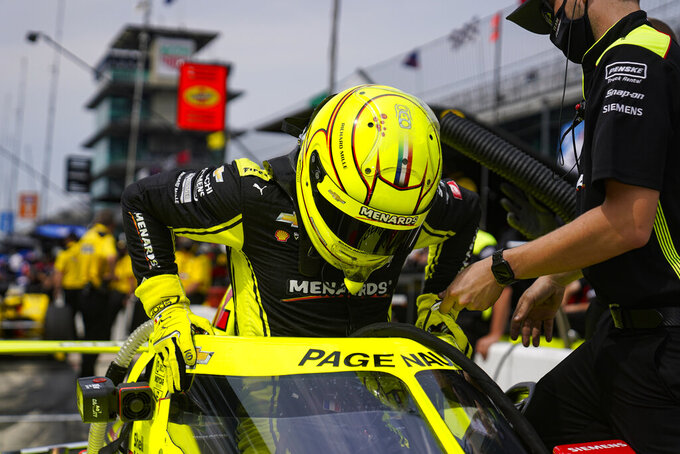 Simon Pagenaud of France climbs into his car during practice for the Indianapolis 500 auto race at Indianapolis Motor Speedway in Indianapolis, Tuesday, May 18, 2021. (AP Photo/Michael Conroy)