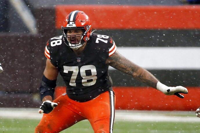 FILE - Cleveland Browns offensive tackle Jack Conklin (78) looks to make a block during an NFL football game against the Las Vegas Raiders in Cleveland, in this Sunday, Nov. 1, 2020, file photo. Conklin was selected Friday, Jan. 8, 2021, to The Associated Press All-Pro Team. (AP Photo/Kirk Irwin, File)