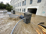 Water runs through the community after heavy rains, some of which flooded in Seblitz, Germany, Tuesday, July 13, 2021. Heavy summer storms caused widespread damage and flooding Tuesday in Germany and Switzerland. (Bernd M'rz/dpa via AP)