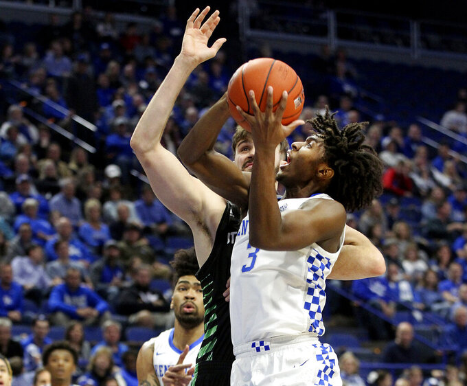 Kentucky's Tyrese Maxey (3) shoots while pressured by Utah Valley's Brandon Morley during the first half of an NCAA college basketball game in Lexington, Ky., Monday, Nov. 18, 2019. (AP Photo/James Crisp)