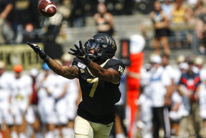 Wake Forest wide receiver Scotty Washington catches a pass against Elon in the first half of an NCAA college football game in Winston-Salem, N.C., Saturday, Sept. 21, 2019. (AP Photo/Nell Redmond)