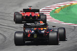 Red Bull driver Max Verstappen of the Netherlands drives behind Ferrari driver Sebastian Vettel of Germany during the 3rd practice session prior to the Formula One Grand Prix at the Barcelona Catalunya racetrack in Montmelo, Spain, Saturday, Aug. 15, 2020. (Josep Lago, Pool via AP)