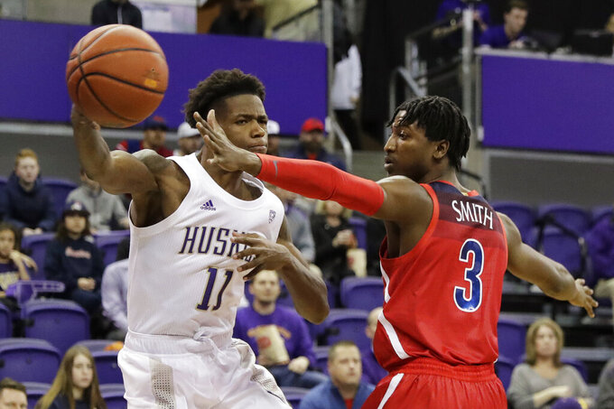 Washington guard Nahziah Carter (11) passes the ball around Arizona guard Dylan Smith (3) during the first half of an NCAA college basketball game Thursday, Jan. 30, 2020, in Seattle. (AP Photo/Ted S. Warren)