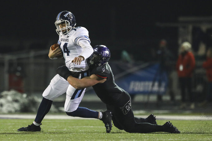 Maine quarterback Chris Ferguson (14) is sacked by Weber State's Adam Rodriguez (9) during the second half in a quarterfinal of the NCAA Football Championship Subdivision playoffs Friday, Dec. 7, 2018, in Ogden, Utah. (Matt Herp/Standard-Examiner via AP)