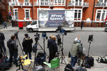 A van with a 'Free Speech' placard and the images of Wikileaks founder Julian Assange and Chelsea Manning on its side, outside the Ecuadorian Embassy in London, Friday, April 5, 2019, where Wikileaks founder Julian Assange has been holed up since 2012. A senior Ecuadorian official said no decision has been made to expel Julian Assange from the country's London embassy despite tweets from Wikileaks that sources had told it he could be kicked out within