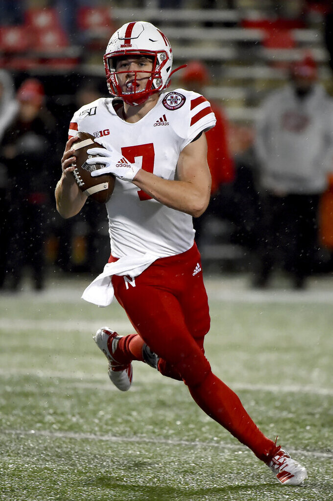 Nebraska quarterback Luke McCaffrey (7) looks to pass during the second half of an NCAA college football game against Maryland, Saturday, Nov. 23, 2019, in College Park, Md. (AP Photo/Will Newton)